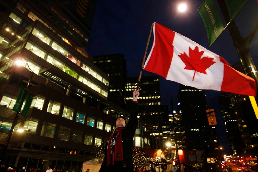 A Canadian fan celebrates their victory against the United States in the final hockey match at ...