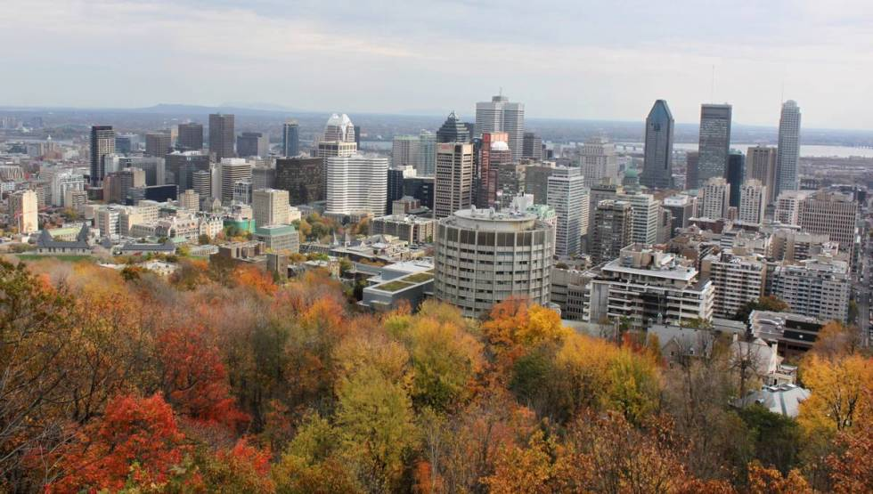 This Oct. 21, 2013 photo shows a view of downtown Montreal taken from Mount Royal park. (AP Pho ...